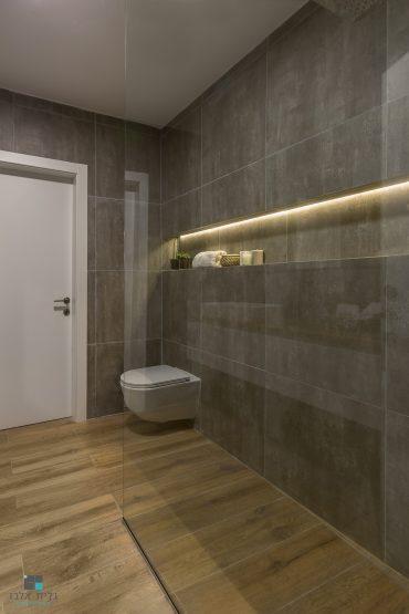 חיבור חומרים מושלם של בטון ועץ למראה מודרני חם. עיצוב: גלית אלבז. צילום: אנה פנצ'קו