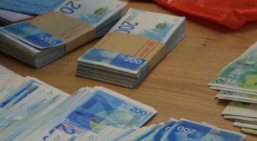 שטרות כסף. צילום: דוברות המשטרה